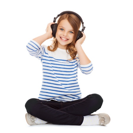 music book: music and technology concept - child with headphones