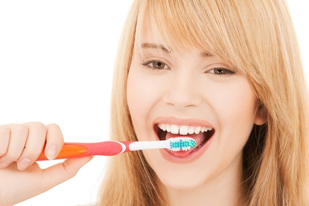 healthcare, medical and stomatology concept - teenage girl with toothbrush photo