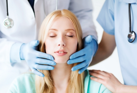 plastic surgeon: healthcare, medical and plastic surgery concept - plastic surgeon or doctor with patient Stock Photo