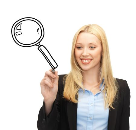 education, science and search concept - woman drawing magnifier on virtual screen photo