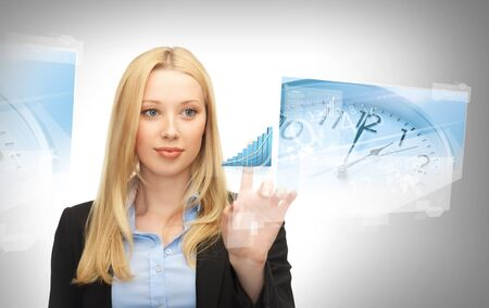 business, future technology and time management concept - businesswoman pointing at graph on virtual screen photo