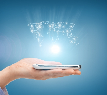 business, technology, internet and networking concept - woman hand with smartphone and virtual screen photo