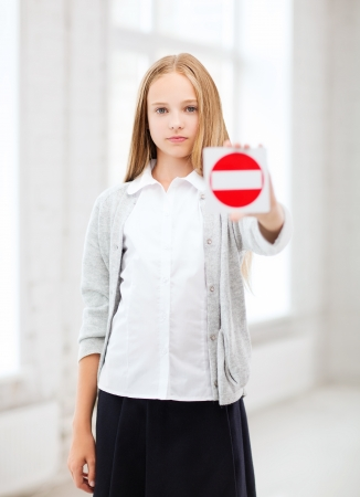 education, school and anti-bullying concept - student girl showing stop sign Stock Photo - 21945839