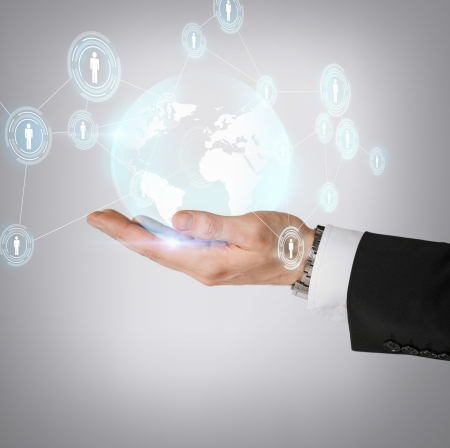 hologram: business, technology, internet and networking concept - man hand holding hologram with globe and contacts
