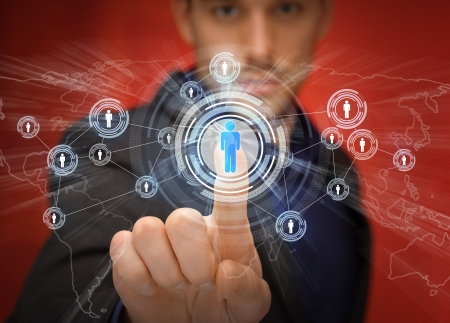 business, technology, internet and networking concept - businessman pressing button with contact on virtual screens Stock Photo - 21945872