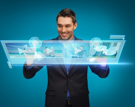 business, technology, internet and networking concept - businessman pressing buttons on virtual screen photo