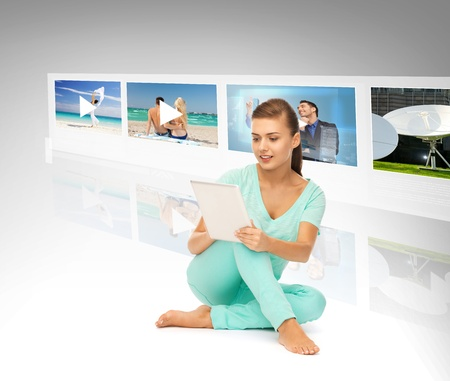technology, internet, tv and news concept - young woman with tablet pc and virtual screens Stock Photo