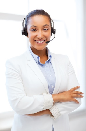 business, communication and call center - african helpline operator with headphones Stock Photo - 21946074