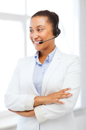 business, communication and call center - african helpline operator with headphones photo