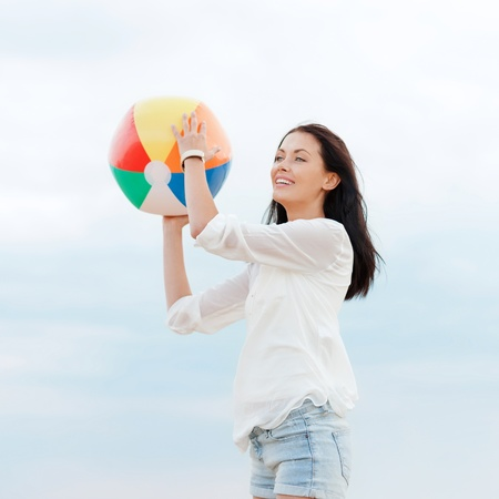 beach ball girl: summer holidays, vacation and beach activities concept - girl with ball on the beach Stock Photo