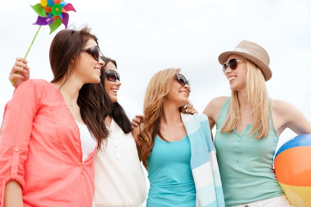 chill out: summer holidays, vacation and beach activities - girls having fun on the beach Stock Photo
