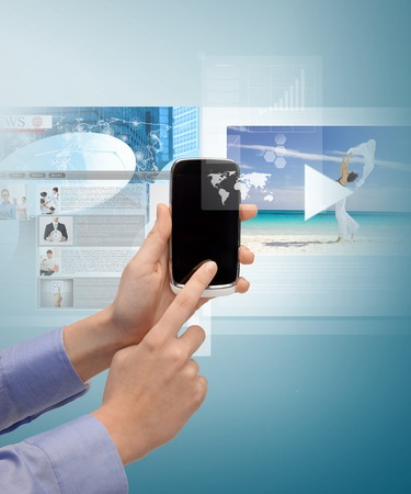 technology, internet, tv and news concept - woman hand with smartphone, videos and virtual screen photo