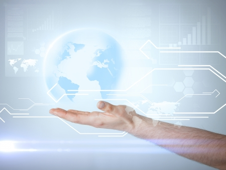technology, news and environment concept - man hand holding virtual sphere globe photo