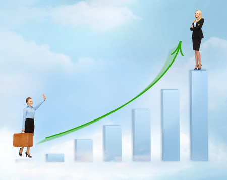 business, success and graphs concept - businesswomen with big 3d chart photo