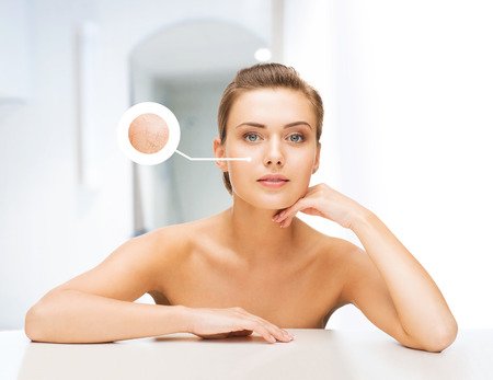 cleanse: beauty and skin care concept - face of beautiful woman with dry skin examples Stock Photo