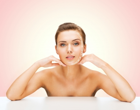 pores: beauty and skin care concept - face of beautiful woman with lines