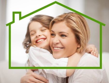 eco house: home, real estate and family concept - mother and daughter with eco house