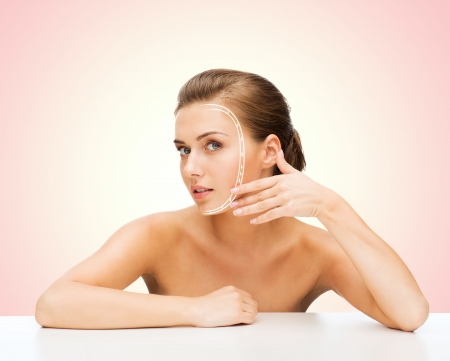 face lift: beauty and skin care concept - face of beautiful woman with lines