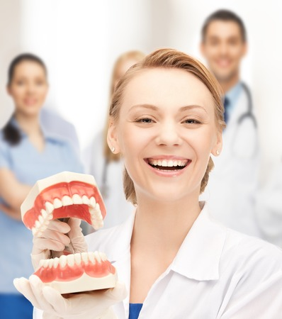 big teeth: healthcare, medical and stomatology concept - attractive female doctor with big jaws Stock Photo