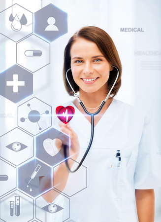 medical technology: healthcare, medical and future technology concept - female doctor with stethoscope and virtual screen Stock Photo
