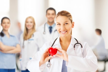 heart disease: healthcare and medical concept - female doctor with heart