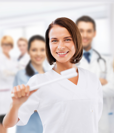 Cleaning team: healthcare, medical and stomatology - dentist with toothbrush in hospital