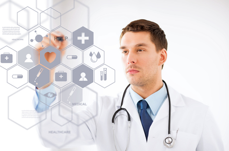 high tech device: healthcare, medical and future technology concept - male doctor with stethoscope and virtual screen Stock Photo
