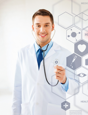 medical technology: healthcare, medical and future technology concept - male doctor with stethoscope and virtual screen Stock Photo