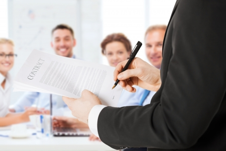 business concept - man signing contract
