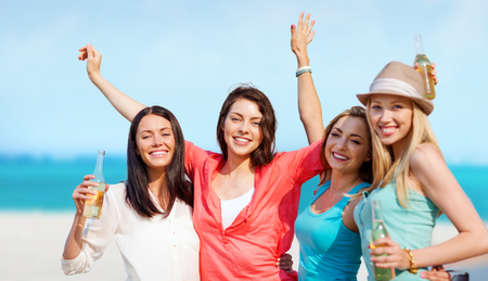 bachelorette: summer holidays and vacation - girls with drinks on the beach Stock Photo
