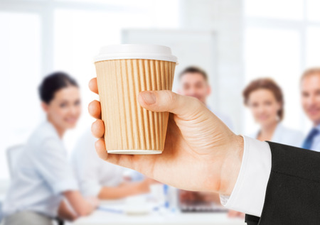 business concept - man holding take away coffee cup photo