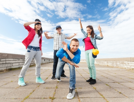 beautiful boys: sport, dancing and urban culture concept - group of teenagers dancing