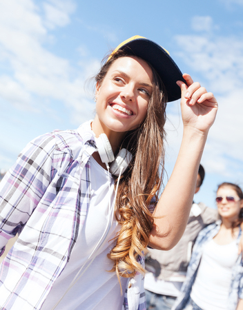 funky music: summer holidays and teenage concept - teenage girl outside Stock Photo