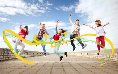 in out: summer, sport, dancing and teenage lifestyle concept - group of teenagers jumping Stock Photo