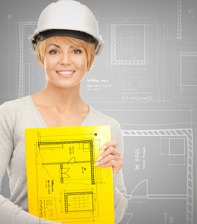 woman engineer: building, developing, consrtuction, architecture concept - female contractor in helmet