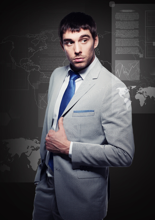 business, office, modern technology - buisnessman with virtual screens photo