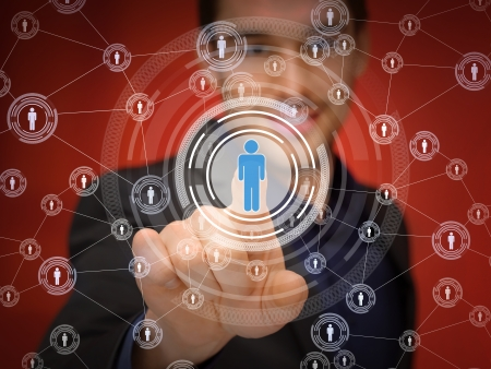 business, technology, internet and networking concept - businessman pressing button with contact on virtual screens Stock Photo - 22184426