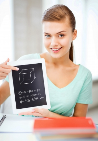 education technology: education, technology and internet concept - smiling student girl with tablet pc Stock Photo