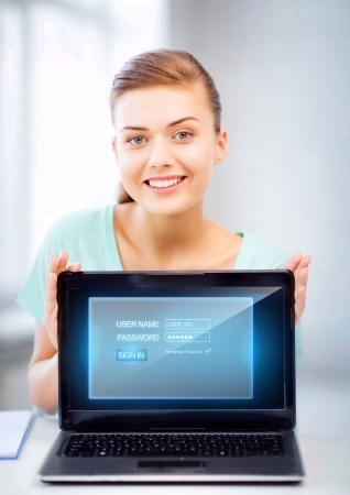 online privacy: picture of happy woman with laptop computer and virtual screen