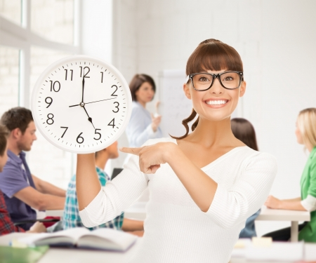 rush hour: education and time management concept - attractive student showing clock