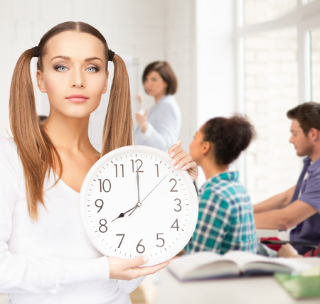 rushing hour: education and time management concept - attractive student showing clock
