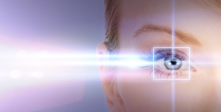 young eyes: health, vision, sight - woman eye with laser correction frame Stock Photo