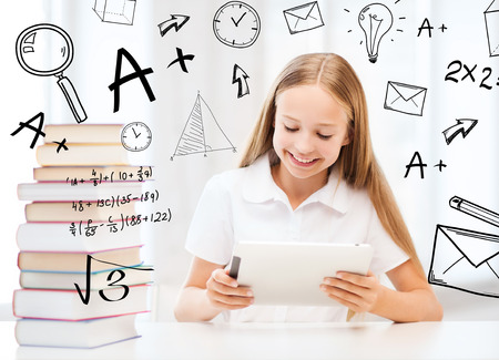 new books: education, school, technology and internet concept - little student girl with tablet pc and books at school