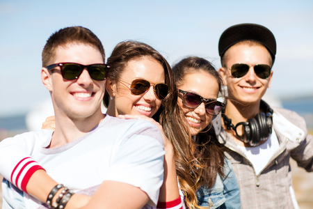 beautiful boys: summer holidays and teenage concept - group of teenagers hanging out outside