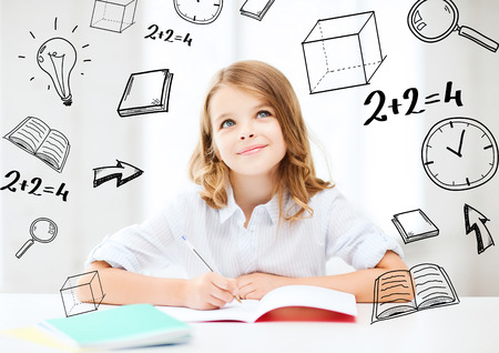 education and school concept - little student girl studying at school Stock Photo