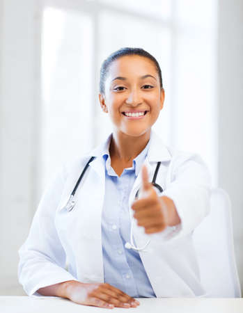 healthcare and medical concept - african doctor with stethoscope showing thumbs up Stock Photo - 22184855