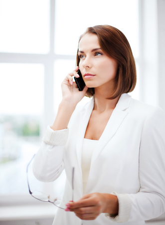 business concept - confused woman with smartphone Stock Photo - 22184928