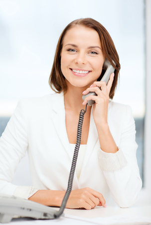 business and helpline concept - businesswoman with rotary phone calling photo