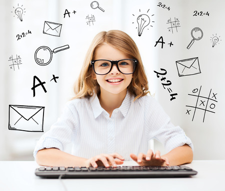 education, school and future technology concept - little student girl with keyboard and imaginary screen at school Фото со стока