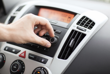 cd player: transportation and vehicle concept - man using car audio stereo system Stock Photo